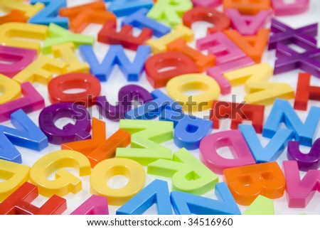 Brightly Colored Childrens Toy Magnetic Alphabet Letters on White Background