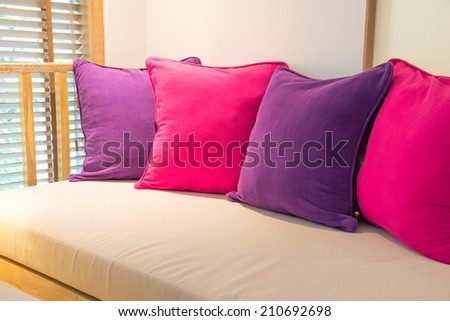 Brightly colored cushions on the sofa. - stock photo