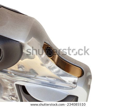 Brightly colored hammer on a revolver isolated on white - stock photo