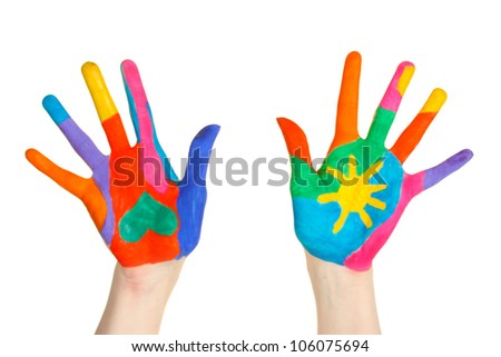 Brightly colored hands on white background close-up - stock photo