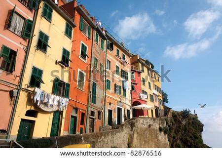 Brightly colored houses in Riomaggiore, Cinque Terre in Italy - stock photo