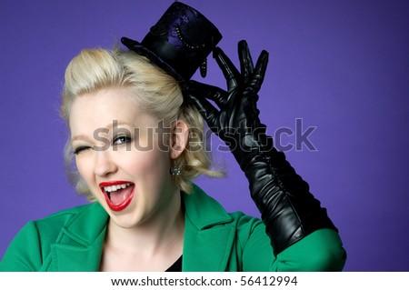 Brightly colored picture of lovely girl in tiny top hat - stock photo