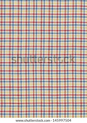 Brightly colored red white blue and yellow plaid fabric swatch textile background.
