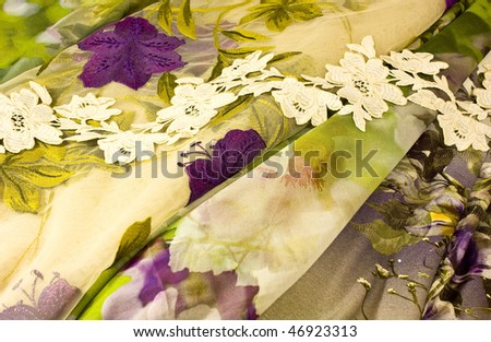 brightly colored set of materials with handmade lace - stock photo