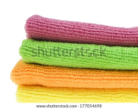 Brightly colored sponges on white background with copy space - stock photo