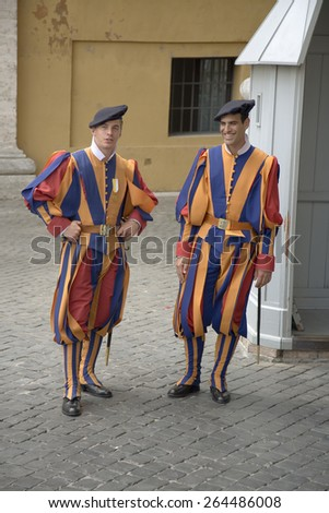 Brightly colored uniforms of Swiss Guard at Vatican City, center of Catholic Church, Rome, Italy, Europe