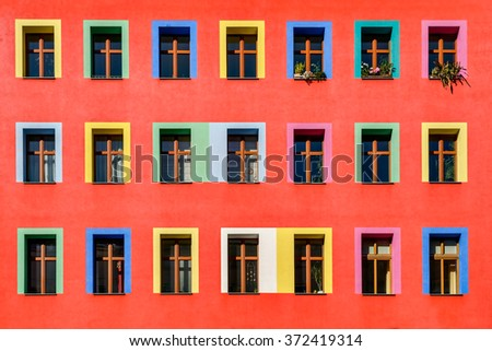 Brightly colorful facade of an apartment building in Berlin-Kreuzberg. - stock photo