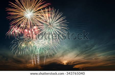 Brightly colorful fireworks and salute of various colors in the night sky, copy space. - stock photo