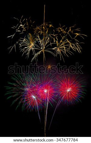 Brightly colorful fireworks and salute of various colors on night sky background