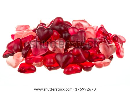 Brightly coloured red gums hearts as valentine present isolated on white background