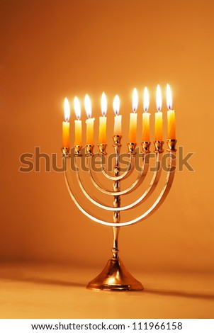 Brightly glowing Hanukkah menorah - stock photo
