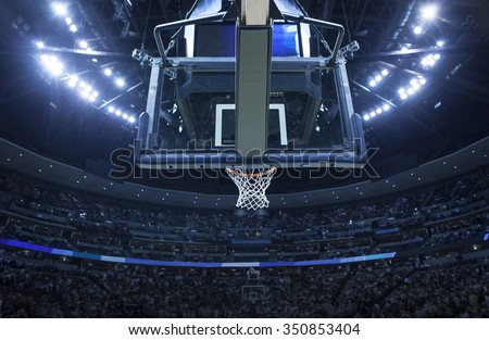 Brightly lit Basketball backboard in a large sports arena. - stock photo