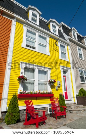 Brightly painted clapboard houses in the city of St John's, Newfoundland, Canada. - stock photo