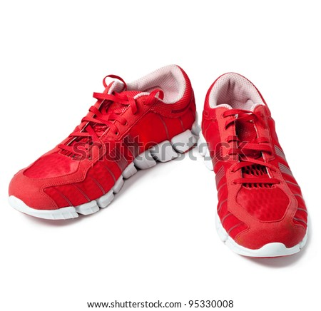Brightly red trainers - stock photo