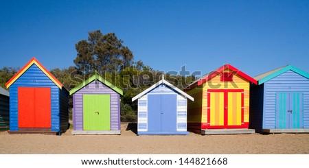 Brighton Beach Bathing Boxes on a summer's day in Melbourne, Victoria, Australia - stock photo