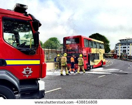 Brighton, England. 4th June 2015. A bus catches fire at a bus stop outside the Royal Pavilion. Fire crews quickly respond to extinguish the fire. Nobody was injured in the incident.