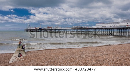 Brighton Marine Palace and Pier, Brighton, United Kingdom-May 30, 2010: Tourists' and locals' popular pleasure and entertainment site with restaurants, coffee shops souvenir shops & more attractions