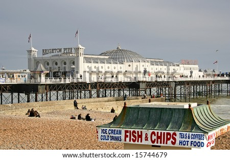 Brighton Pier with old fish and chip shop in the front - stock photo