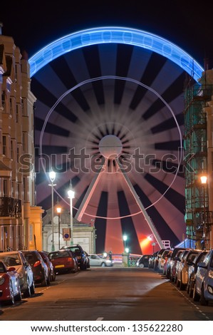 brighton street scene with ferris wheel - stock photo