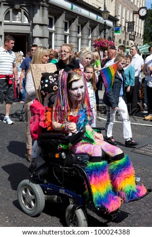 BRIGHTON, UK - AUG 13. A disabled girl from the LGBT community take part in the the pride parade with colorful body painting at Brighton Pride Festival on August 13, 2011.