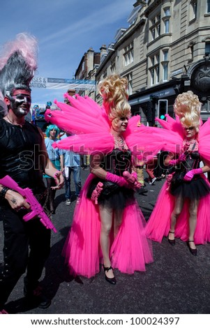 BRIGHTON, UK - AUG 13. Participants from the LGBT community dress in pink themed costumes in the pride parade at Brighton Pride Festival on August 13, 2011.