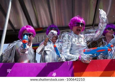 BRIGHTON, UK - AUG 13. Participants from the LGBT community in futuristic themed costumes join the pride parade at Brighton & Hove Pride Festival on August 13, 2011. - stock photo