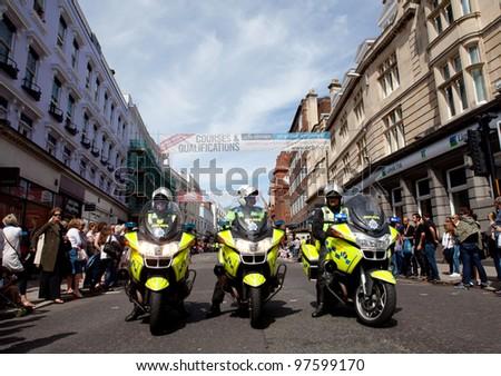 BRIGHTON, UK - AUG 13. The polices with their motorcycles are ready and waiting for the pride parade for LGBT community at  Brighton Pride Festival on August 13, 2011. - stock photo