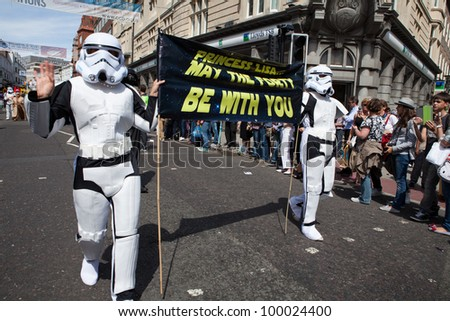 BRIGHTON, UK - AUG 13. Two of the LGBT participants in the Star Wars soldier costume take part in the pride parade at Brighton Pride Festival on August 13, 2011. - stock photo