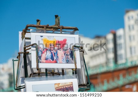 BRIGHTON, UK - JULY 28: Postcards of Brighton Gay Pride Parade for sale on the seafront in the popular seaside town in July 2013 - stock photo