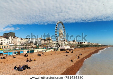 Brighton, UK - 5  March 2014 : People enjoy the sunny and dry weather to spend time on the beach in Brighton and Hove.