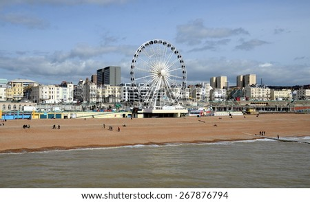 BRIGHTON, UK - MARCH 27: View on Brighton Wheel and Beach from the Brighton Pier. Brighton, UK - March 27, 2015 - stock photo