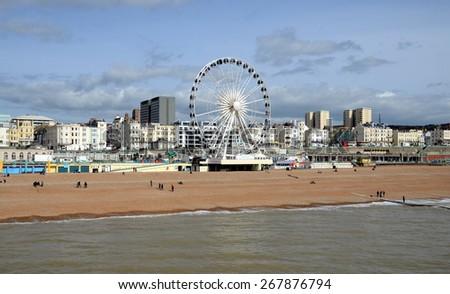 BRIGHTON, UK - MARCH 27: View on Brighton Wheel and Beach from the Brighton Pier. Brighton, UK - March 27, 2015 - stock photo