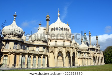 Brighton, United Kingdom - October 01, 2014: Summer sunshine on the Eastern inspired towers of the historic Royal Brighton Pavilion buildings. - stock photo