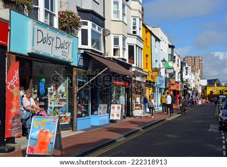 Brighton, United Kingdom - October 01, 2014: Tourists shopping in the famous North Laines district of Brighton, Surrey.