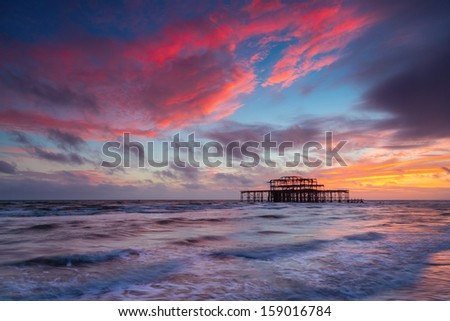 Brighton West Pier at Sunset, Sussex, England, UK. Long Exposure - stock photo