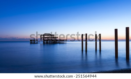 Brighton West Pier at the sunset. - stock photo