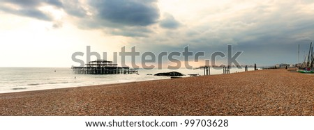 Brighton westpier and beach, the old burned down pier in evening light - stock photo