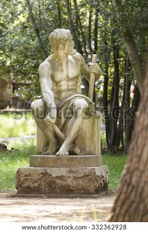 BRIJUNI, CROATIA - MAY 2015 - Big statue of a man with hammers in his hands.