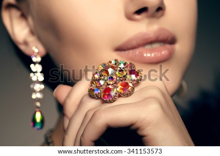 Brilliant. Antique old vintage earrings and ring. Jewelry on her finger at the girl close-up