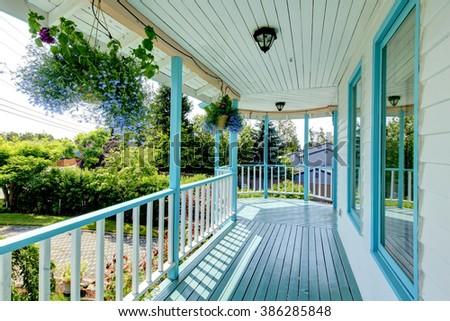 Brilliant blue front deck of unique home. - stock photo