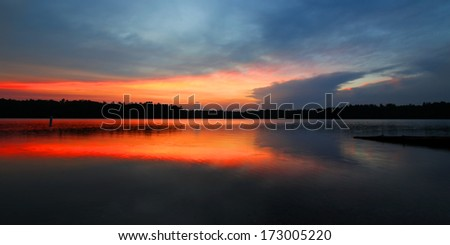 Brilliant colors of sunset over Buffalo Lake in the Northern Highland American Legion State Forest of Wisconsin - stock photo