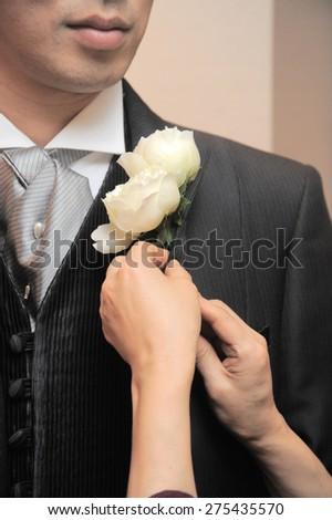 Brilliant corsage groom chest - stock photo