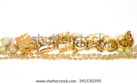 Brilliant gold baubles like christmas decoration. Yellow balls ribbon, gift, bow and tinsel isolated on white background. - stock photo