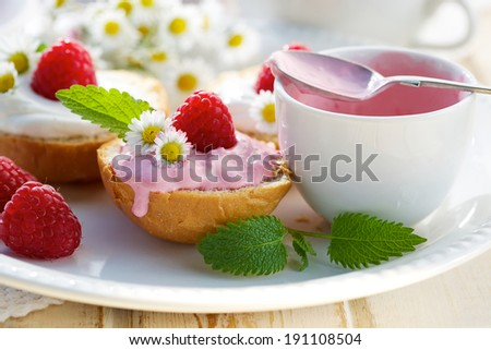 Brioche buns with fruity creamy cheese and fresh raspberries - stock photo