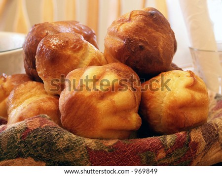 Brioches - a tasty traditional French breakfast pastry, dipped either in hot chocolate or coffee. - stock photo