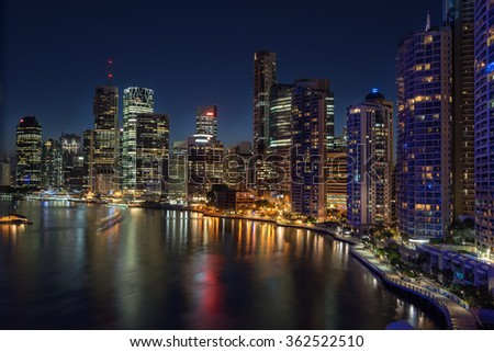 Brisbane at night from across the Brisbane River - stock photo
