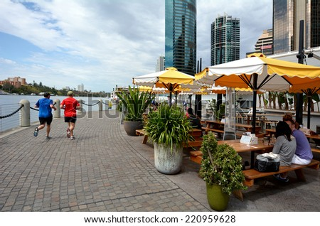 BRISBANE, AUS - SEP 25 2014: Activity at Eagle Street Pier.It is an iconic waterfront precinct with world class dining options and unrivaled views of the Brisbane River.  - stock photo