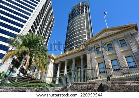 BRISBANE, AUS - SEP 26 2014: Brisbane Customs House under the Aurora Tower. Customs House is one of the most famous Brisbane's heritage building icons. - stock photo