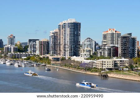 BRISBANE, AUS - SEP 26 2014: Ferry service cruise over Brisbane River. It's the longest river in south east Queensland, Australia,  flows through the city of Brisbane, before emptying into Moreton Bay.