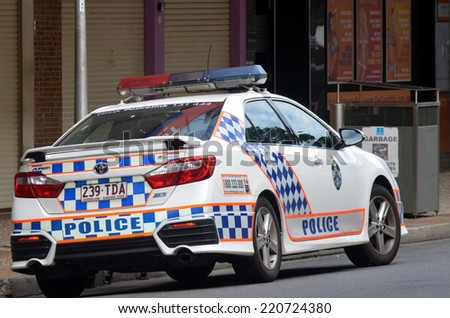 BRISBANE, AUS - SEP 25 2014:Queensland Police car patrol.Gold Coast police on high terror alert warned to be hyper vigilant and patrol local mosques and critical infrastructure sites - stock photo